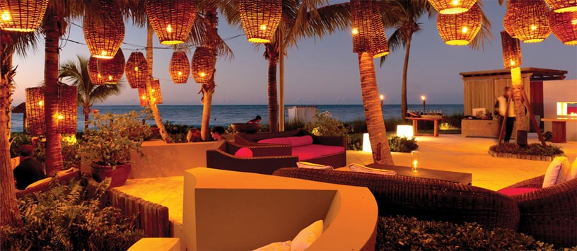 Ultra romantic 'The Lounge' at Grace Bay Club - Caribbean-infused tapas dishes, a selection of martinis and tropical cocktails, sophisticated world music and front-view seating for Providenciales' beautiful sunsets!